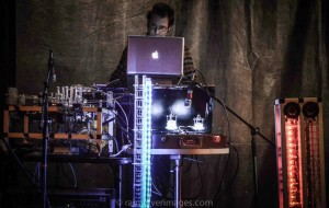 Composer Troy Rogers performs with the robotic musical instruments Stemmetje (a vocal robot), AMI (Automatic Monochord Instrument), CARI (Cylindrical Aerophone Robotic Instrument), and MADI (Multi-mallet Automatic Drumming Instrument).